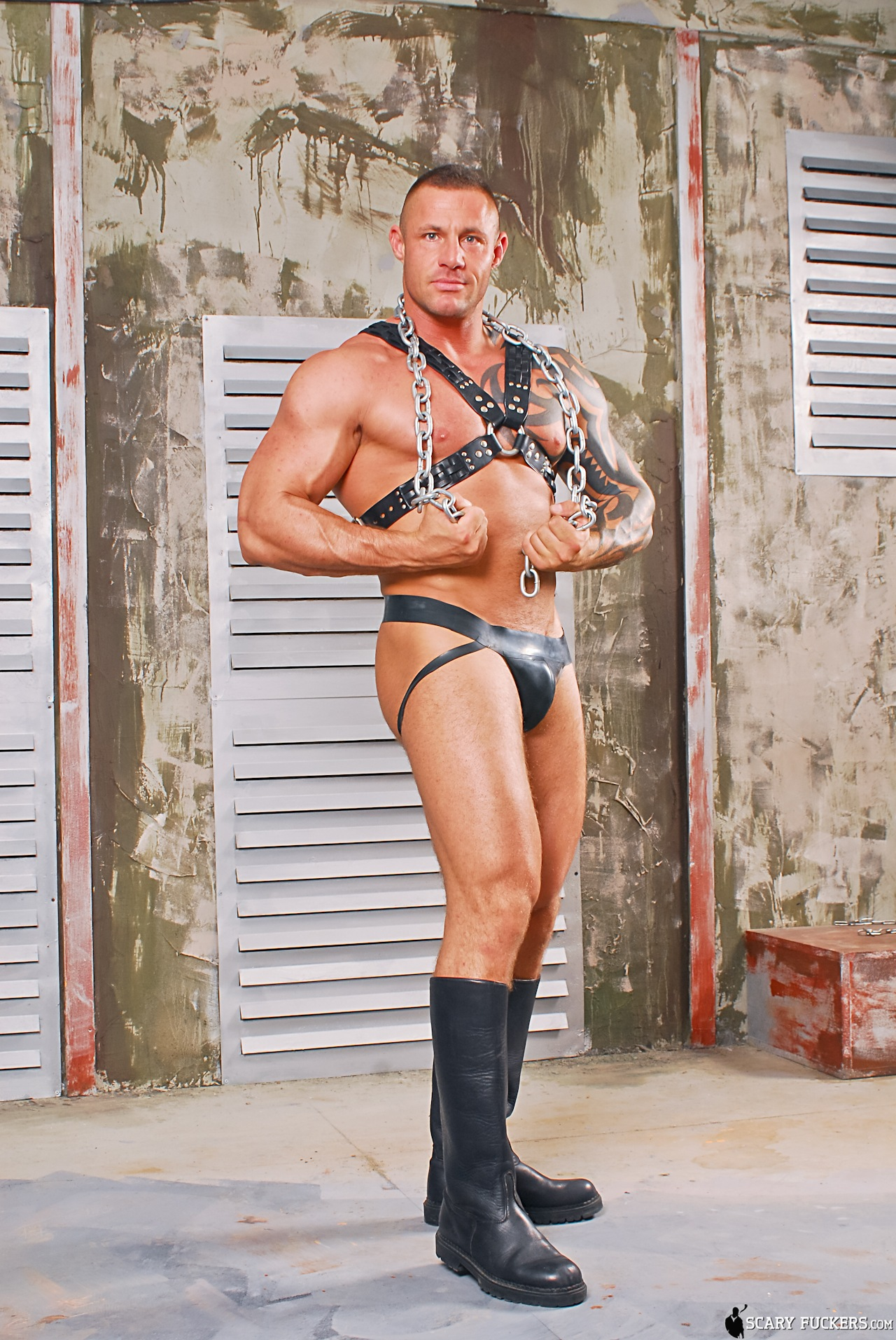 big muscle man in leather gear